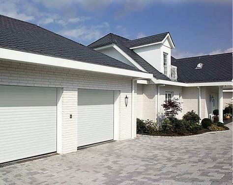 Installation d une porte de garage enroulable pour for Installation porte de garage enroulable